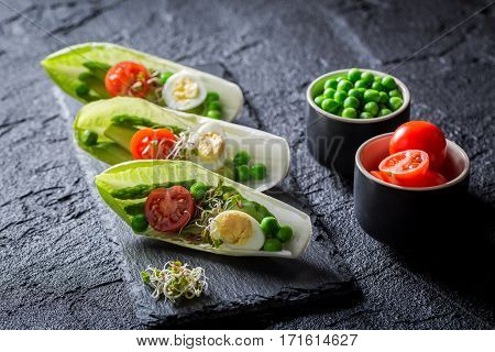 Creative Salad In Chicory With Egg, Sprouts And Avocado