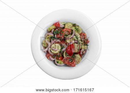 salad cucumber tomatoes with walnuts traditional Georgian dish white background top view