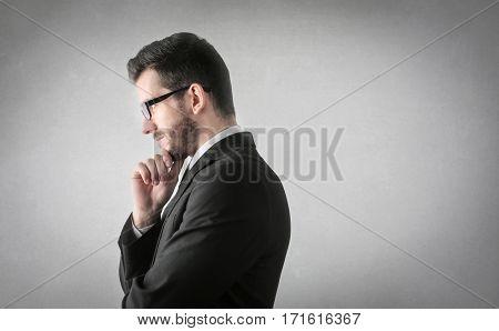 Businessman's profie while thinking