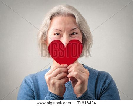 Lady covering her smile with a heart