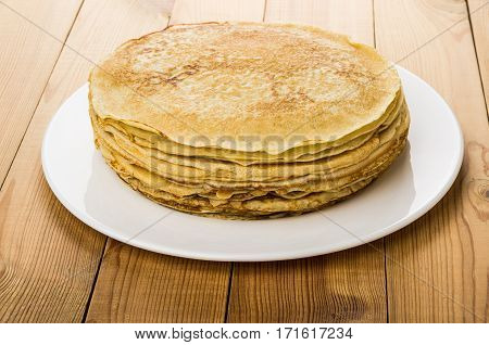 Stack Of Russian Pancakes In Glass Dish On Table