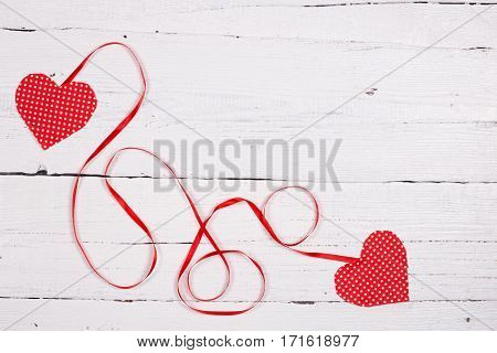 Wooden Background With Two Red Hearts