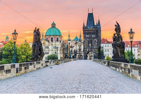 Prague Czech Republic. Charles Bridge (Karluv Most) and Old Town Tower at sunrise.