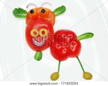 creative funny vegetable food snack with tomato cow form