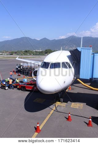 Passenger plane in the airport. Aircraft maintenance