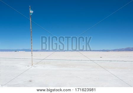 Salinas Grandes and a flag of Argentina