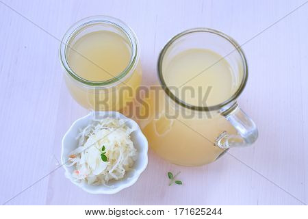 Sauerkraut- fermented cabbage juice in a glass.