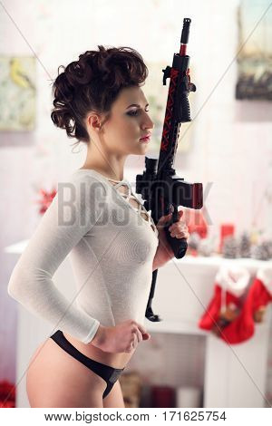 Sexy Woman In A Black Lingerie With A Weapon