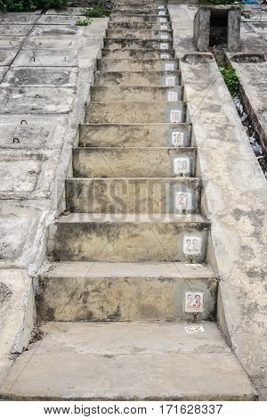 the dirty concrete stairs with sequence numbers