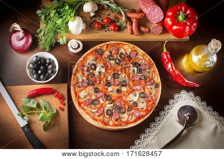 Pizza with ham pepper and olives. Pepperoni pizza with kalamata olives. Supreme Pizza and olive oil.