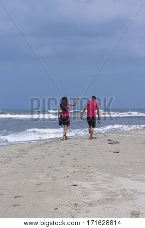 Couple walking on the beach on a summer day