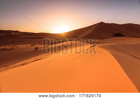 A beautiful sunrise at the dunes of Erg Chebbi located in the Sahara, Morocco.
