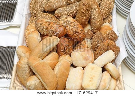 Various Bread Buns Rolls With Seeds in Basket