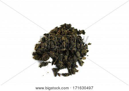 Heap pile of milk oolong green tea isolated on white background