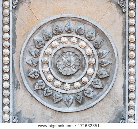 Closeup to Symbol of Buddhism Rowel Stucco in Temple