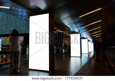Blank electronic billboards with copy space for your text message or content public information boards in underground crossing advertising mock up with movement of walking people on the background