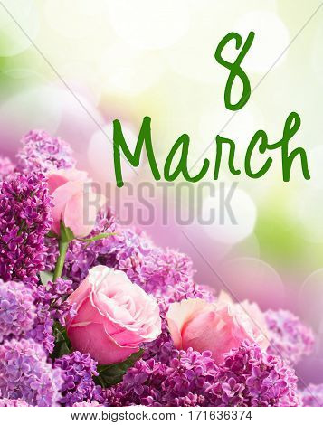 Border of purple Lilac flowers with pink roses in spring garden for 8 March international womens day