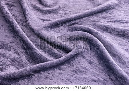 Lilac silk velvet close-up. Fabric macro for texture and background