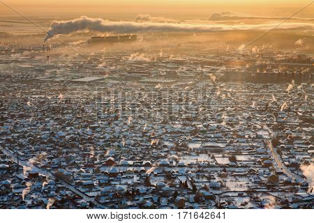 Tyumen, Russia - February 08, 2017: Aerial view on residential area with power factory on background during cold winter morning