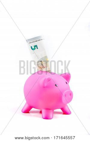 Piggyspace with five Euro banknote isolated against white