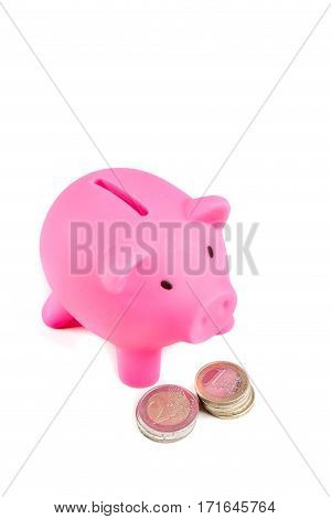 Piggybank with one and two Euro coins