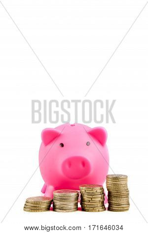 Piggybank with raising stacks of coins with copy space