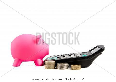 Piggybank with calculator and stacks of coins