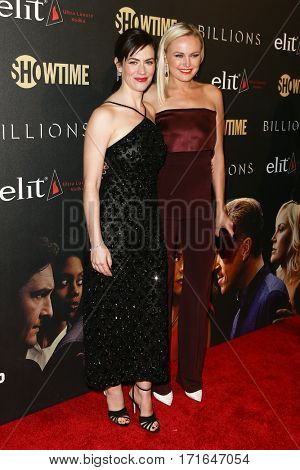 Actresses Maggie Siff (L) and Malin Akerman attend the