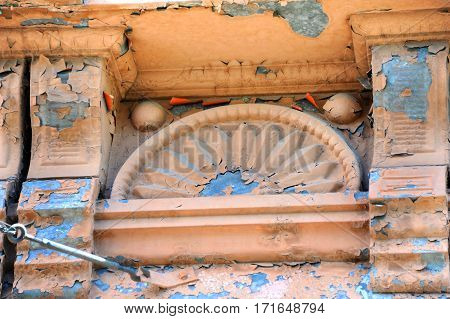 Eaves of historic Bozeman Hotel in Bozeman Montana is cracked and peeling with age. 1800s building is on the register of historic places.