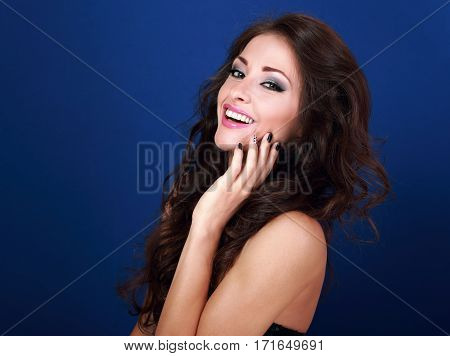 Beautiful Laughing Makeup Woman With Long Volume Hairdo And Manicured Nails On Bright Blue Backgroun