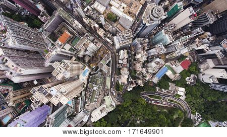 Top view aerial photo from flying drone of developed China city with tall skyscrapers and advanced transportation infrastructure.Office buildings in Hong Kong business district. Background for website