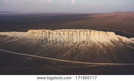Aerial photo from flying drone of sandstone canyon in arid wilderness landscape. Flight over American National Park with rock mountain in desert valley. Beautiful nature background for travel website