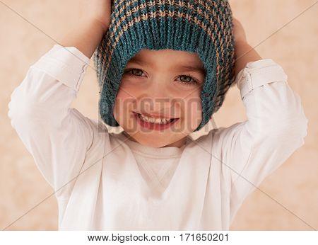 Portrait Of A Beautiful Boy In The Hat