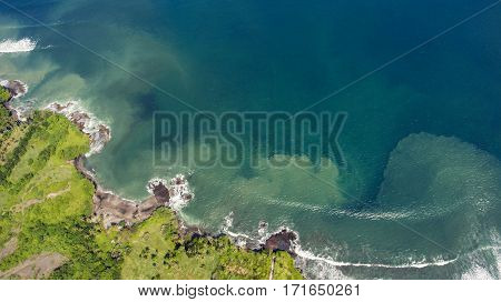Aerial photo from flying drone of amazingly beautiful landscape of nature with paradise beach and residential area with resort hotels and luxury villas near the sea. Concept of a calm summer rest