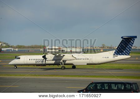 BOSTON - MAY. 6, 2015: Porter Airlines Dash-8-400 (Q400) taxiing at Boston Logan International Airport, Boston, Massachusetts, USA.