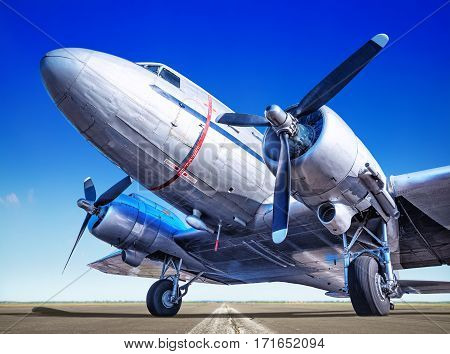 historic airplane on a runway waiting for take off