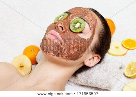 spring health people youth and beauty concept -Natural homemade fruit facial masks. Fresh fruit. Spa Woman applying Facial cleansing Mask. Beauty Treatments