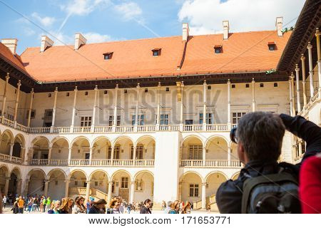 Krakow, Poland - May 16, 2015: Photographer Taking Shots At Central Part Of Well-known Wawel Royal C