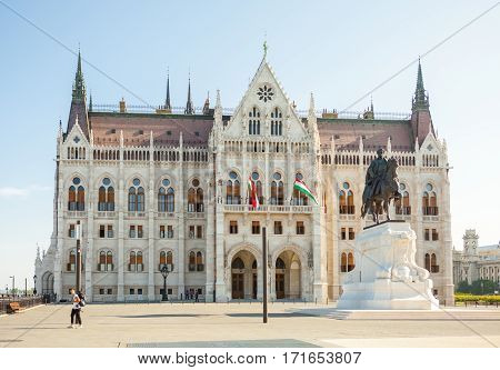 Budapest, Hungary - June 16, 2016: Tourist Walking Away From Hungarian Parliament Building In Budape