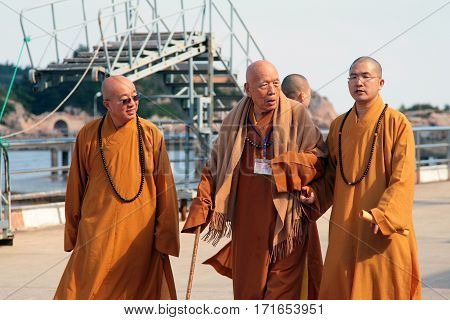 Putuoshan, China - Nov 11, 2008: Group Of Buddhist Monks At The Pier Of Island Putuoshan. Every Year