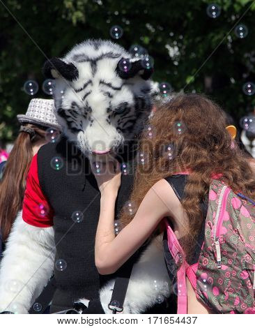 Moscow, Russia - May 18, 2014: Cosplayer Dressed As Tiger And A Girl At Cosplay Festival At The All-