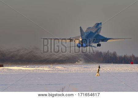 Shaikovka, Kaluga Region, Russia - December 19, 2012: Routine busy day at the airbase. Flying of Tu-22M3 (a supersonic, variable-sweep wing, long-range strategic and maritime strike bomber designed by the Tupolev Design Bureau in the Soviet Union)