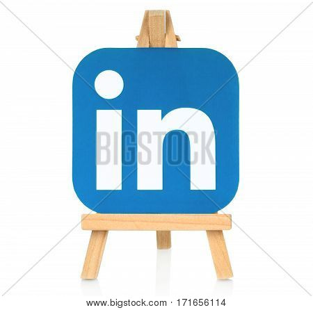 Kiev Ukraine - August 30 2016: LinkedIn logo printed on paper and placed on wooden easel. LinkedIn is a well-known social networking service