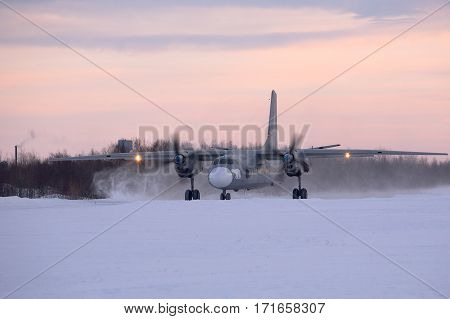 everomorsk, Murmansk Region, Russia - February 28, 2012: Routine busy day at the airbase. Flying of An-26 (is a twin-engined turboprop civilian and military transport aircraft, designed and produced in the Soviet Union from 1969 to 1985)