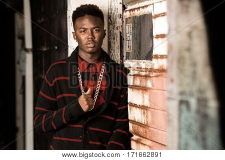 One african american male posing for high school senior portraits