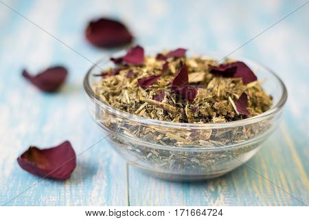 Herbal Tea With Rose Petals On A Rustic Table.