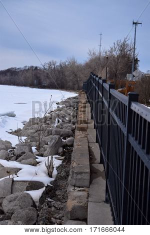 Fence by lake in the winter in the Midwest