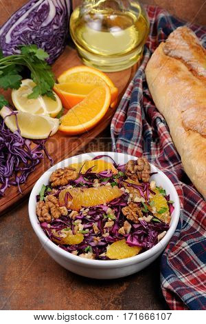 red coleslaw salad with slices of oranges and walnuts