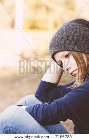 Lonely sad teen girl portrait at autumn