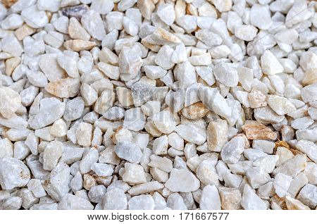White stones background of small pebble on coast